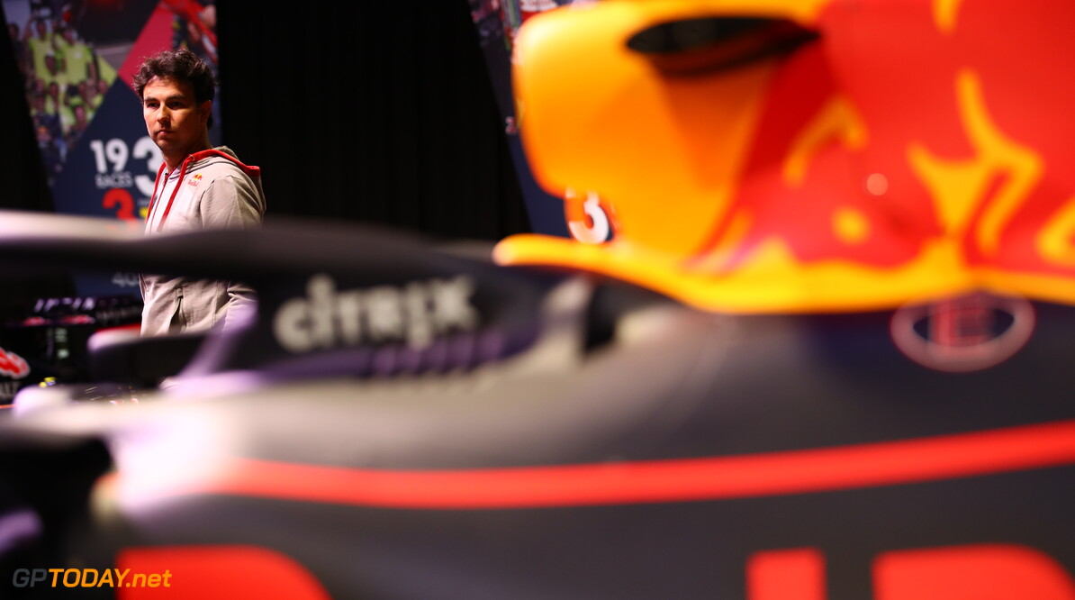 MILTON KEYNES, ENGLAND - JANUARY 11: Sergio Perez of Mexico and Red Bull Racing looks at the history of the team at MK-7 at Red Bull Racing Factory on January 11, 2021 in Milton Keynes, England. (Photo by Mark Thompson/Getty Images) // Getty Images / Red Bull Content Pool  // SI202101200079 // Usage for editorial use only //  Sergio Perez Visits Red Bull Racing Factory     SI202101200079