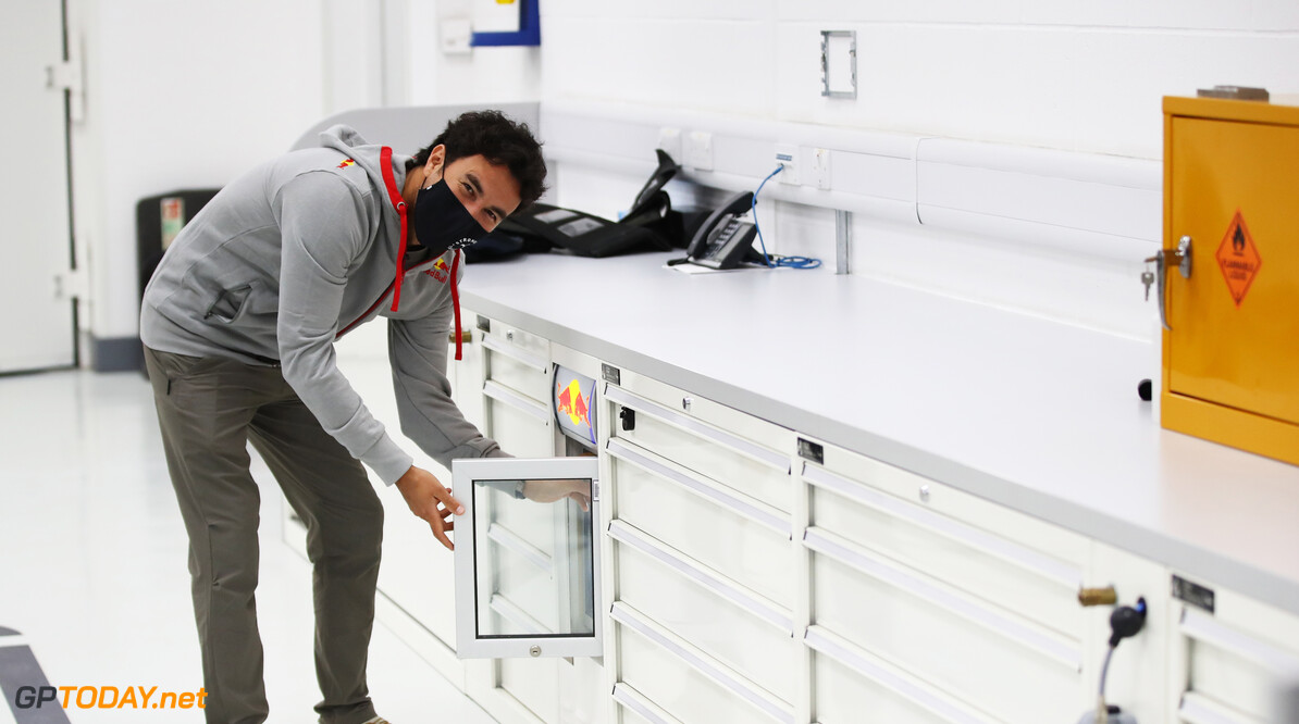 MILTON KEYNES, ENGLAND - JANUARY 11: Sergio Perez of Mexico and Red Bull Racing looks around the engineering cupboards at Red Bull Racing Factory on January 11, 2021 in Milton Keynes, England. (Photo by Mark Thompson/Getty Images) // Getty Images / Red Bull Content Pool  // SI202101200085 // Usage for editorial use only //  Sergio Perez Visits Red Bull Racing Factory     SI202101200085