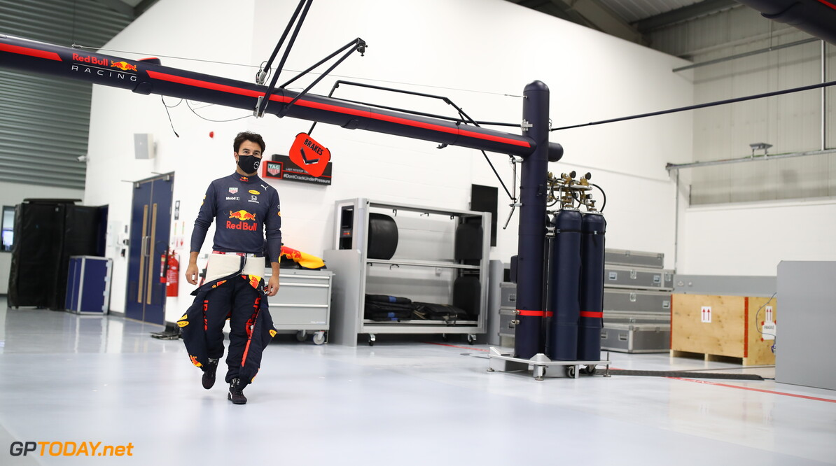 MILTON KEYNES, ENGLAND - JANUARY 12: Sergio Perez of Mexico and Red Bull Racing walks in the engineering bays at Red Bull Racing Factory on January 12, 2021 in Milton Keynes, England. (Photo by Mark Thompson/Getty Images) // Getty Images / Red Bull Content Pool  // SI202101200080 // Usage for editorial use only //  Sergio Perez Visits Red Bull Racing Factory     SI202101200080