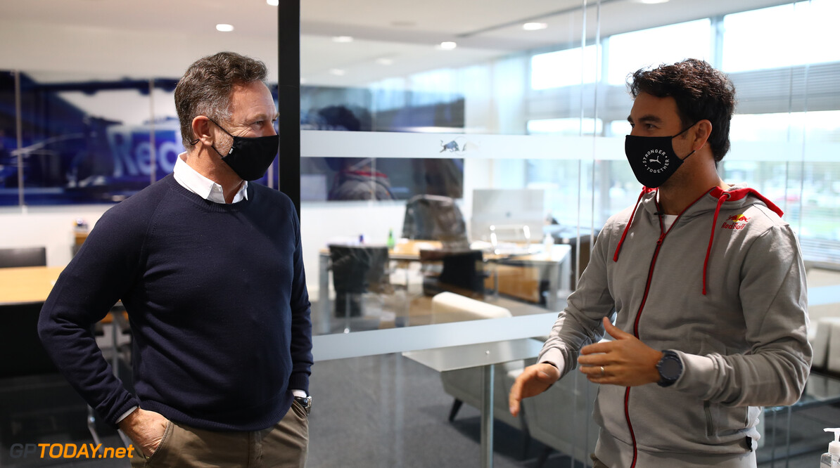 MILTON KEYNES, ENGLAND - JANUARY 11: Sergio Perez of Mexico and Red Bull Racing talks with Red Bull Racing Team Principal Christian Horner at Red Bull Racing Factory on January 11, 2021 in Milton Keynes, England. (Photo by Mark Thompson/Getty Images) // Getty Images / Red Bull Content Pool  // SI202101200083 // Usage for editorial use only //  Sergio Perez Visits Red Bull Racing Factory     SI202101200083