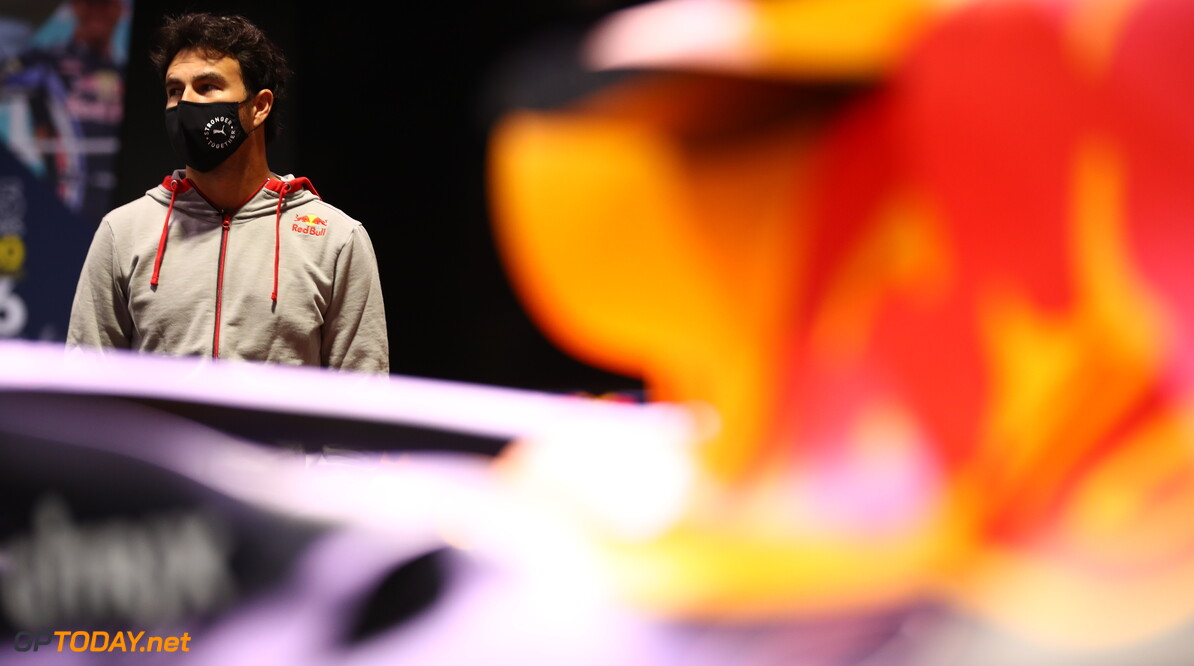 MILTON KEYNES, ENGLAND - JANUARY 11: Sergio Perez of Mexico and Red Bull Racing looks at the history of the team at MK-7 at Red Bull Racing Factory on January 11, 2021 in Milton Keynes, England. (Photo by Mark Thompson/Getty Images) // Getty Images / Red Bull Content Pool  // SI202101200081 // Usage for editorial use only //  Sergio Perez Visits Red Bull Racing Factory     SI202101200081