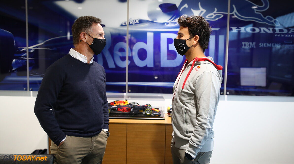 MILTON KEYNES, ENGLAND - JANUARY 11: Sergio Perez of Mexico and Red Bull Racing talks with Red Bull Racing Team Principal Christian Horner at Red Bull Racing Factory on January 11, 2021 in Milton Keynes, England. (Photo by Mark Thompson/Getty Images) // Getty Images / Red Bull Content Pool  // SI202101200101 // Usage for editorial use only //  Sergio Perez Visits Red Bull Racing Factory     SI202101200101