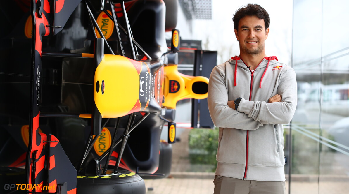 MILTON KEYNES, ENGLAND - JANUARY 11: Sergio Perez of Mexico and Red Bull Racing poses for a photo at Red Bull Racing Factory on January 11, 2021 in Milton Keynes, England. (Photo by Mark Thompson/Getty Images) // Getty Images / Red Bull Content Pool  // SI202101200093 // Usage for editorial use only //  Sergio Perez Visits Red Bull Racing Factory     SI202101200093