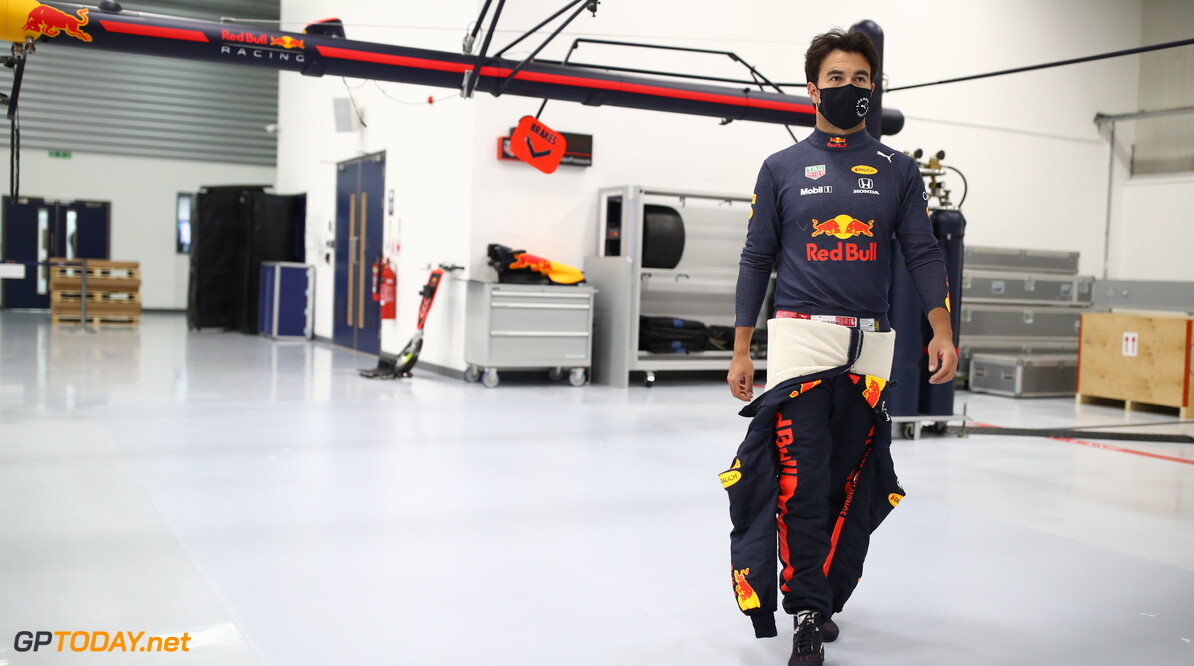 MILTON KEYNES, ENGLAND - JANUARY 12: Sergio Perez of Mexico and Red Bull Racing walks in the engineering bays at Red Bull Racing Factory on January 12, 2021 in Milton Keynes, England. (Photo by Mark Thompson/Getty Images) // Getty Images / Red Bull Content Pool  // SI202101200095 // Usage for editorial use only //  Sergio Perez Visits Red Bull Racing Factory     SI202101200095