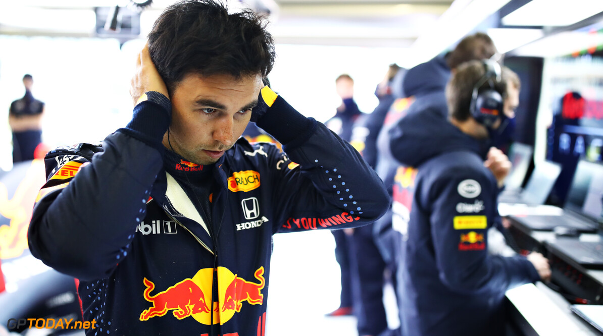 NORTHAMPTON, ENGLAND - FEBRUARY 23: Sergio Perez of Mexico and Red Bull Racing prepares to drive in the garage during the Red Bull Racing filming day at Silverstone on February 23, 2021 in Northampton, England. (Photo by Mark Thompson/Getty Images for Red Bull Racing) // Getty Images / Red Bull Content Pool  // SI202102230151 // Usage for editorial use only //  Red Bull Racing Filming Day     SI202102230151