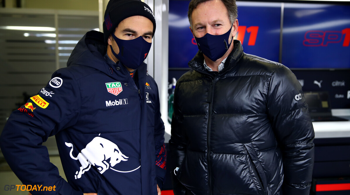 NORTHAMPTON, ENGLAND - FEBRUARY 22: Sergio Perez of Mexico and Red Bull Racing talks with Red Bull Racing Team Principal Christian Horner in the garage during the Red Bull Racing filming day at Silverstone on February 22, 2021 in Northampton, England. (Photo by Mark Thompson/Getty Images for Red Bull Racing) // Getty Images / Red Bull Content Pool  // SI202102230158 // Usage for editorial use only //  Red Bull Racing Filming Day     SI202102230158