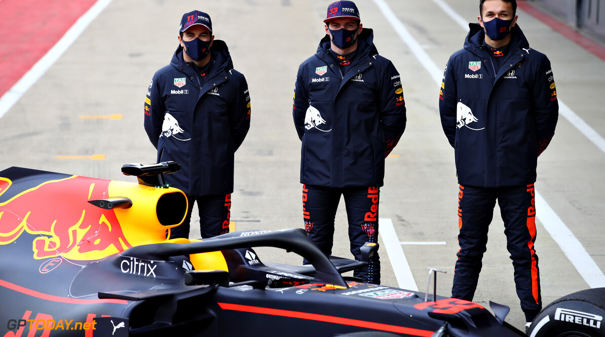 NORTHAMPTON, ENGLAND - FEBRUARY 24: Sergio Perez of Mexico and Red Bull Racing, Max Verstappen of Netherlands and Red Bull Racing and Alexander Albon of Thailand and Red Bull Racing pose for a photo with the RB15 during the Red Bull Racing Filming Day at Silverstone on February 24, 2021 in Northampton, England. (Photo by Mark Thompson/Getty Images for Red Bull Racing) // Getty Images / Red Bull Content Pool  // SI202102240219 // Usage for editorial use only //  Red Bull Racing Filming Day     SI202102240219
