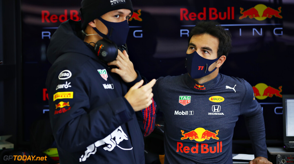 NORTHAMPTON, ENGLAND - FEBRUARY 24: Sergio Perez of Mexico and Red Bull Racing talks with Alexander Albon of Thailand and Red Bull Racing in the garage during the Red Bull Racing Filming Day at Silverstone on February 24, 2021 in Northampton, England. (Photo by Mark Thompson/Getty Images for Red Bull Racing) // Getty Images / Red Bull Content Pool  // SI202102240150 // Usage for editorial use only //  Sergio P?? 1/2 rez and Alexander Albon     SI202102240150