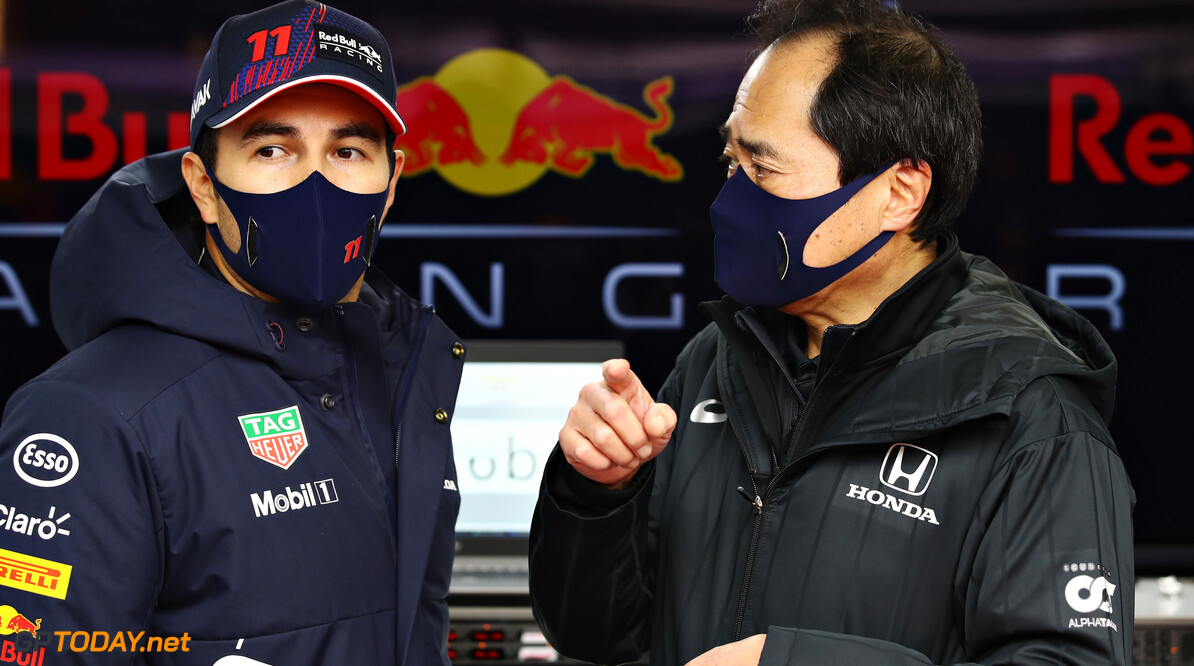 NORTHAMPTON, ENGLAND - FEBRUARY 24: Sergio Perez of Mexico and Red Bull Racing talks with Toyoharu Tanabe of Honda during the Red Bull Racing Filming Day at Silverstone on February 24, 2021 in Northampton, England. (Photo by Mark Thompson/Getty Images for Red Bull Racing) // Getty Images / Red Bull Content Pool  // SI202102240218 // Usage for editorial use only //  Red Bull Racing Filming Day     SI202102240218