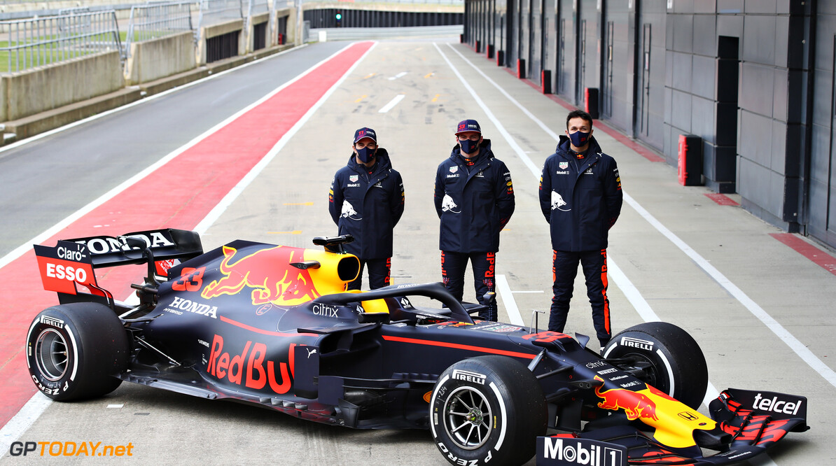 NORTHAMPTON, ENGLAND - FEBRUARY 24: Sergio Perez of Mexico and Red Bull Racing, Max Verstappen of Netherlands and Red Bull Racing and Alexander Albon of Thailand and Red Bull Racing pose for a photo with the RB15 during the Red Bull Racing Filming Day at Silverstone on February 24, 2021 in Northampton, England. (Photo by Mark Thompson/Getty Images for Red Bull Racing) // Getty Images / Red Bull Content Pool  // SI202102240217 // Usage for editorial use only //  Red Bull Racing Filming Day     SI202102240217