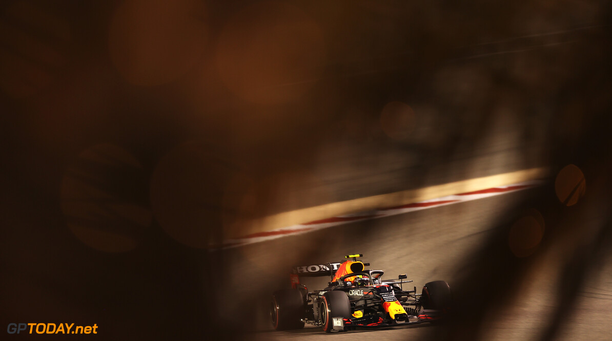 BAHRAIN, BAHRAIN - MARCH 27: Sergio Perez of Mexico driving the (11) Red Bull Racing RB16B Honda on track during qualifying ahead of the F1 Grand Prix of Bahrain at Bahrain International Circuit on March 27, 2021 in Bahrain, Bahrain. (Photo by Lars Baron/Getty Images) // Getty Images / Red Bull Content Pool  // SI202103270311 // Usage for editorial use only //  F1 Grand Prix of Bahrain - Qualifying     SI202103270311