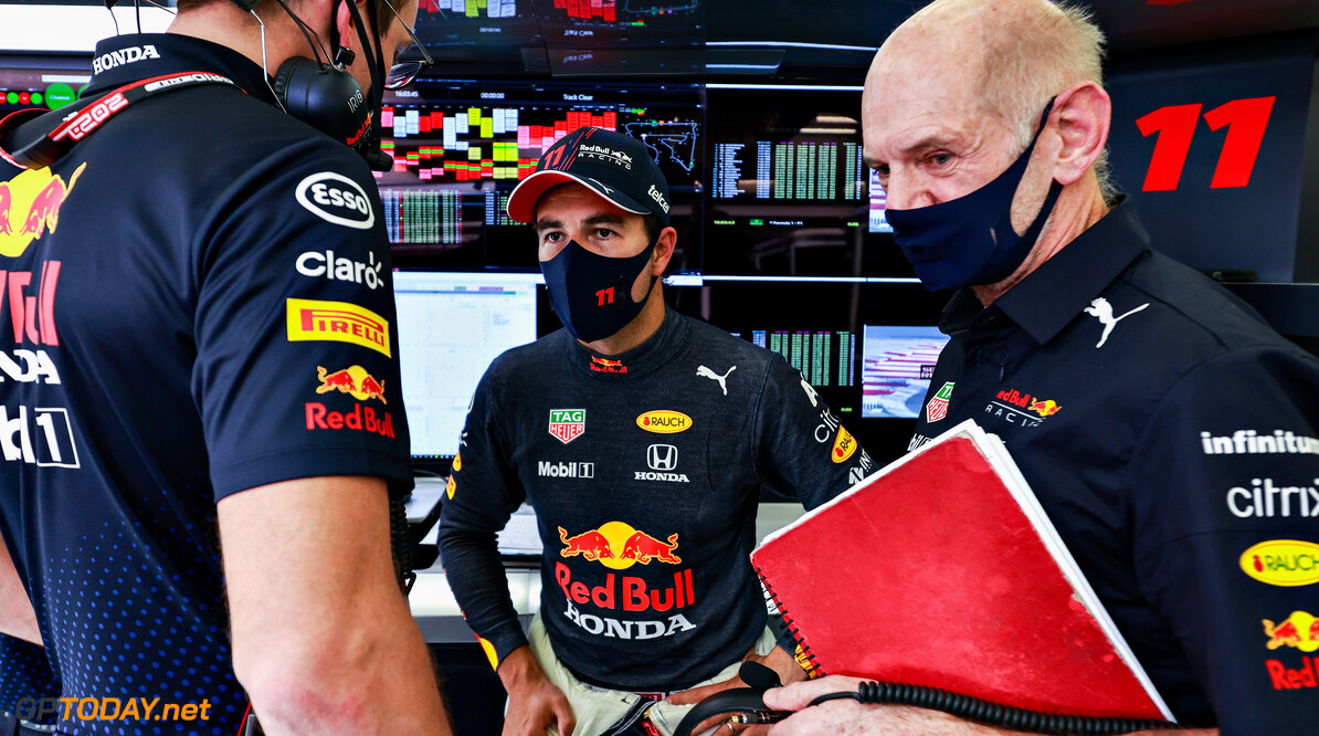 BAHRAIN, BAHRAIN - MARCH 27: Sergio Perez of Mexico and Red Bull Racing talks with his race engineer Hugh Bird and Adrian Newey, the Chief Technical Officer of Red Bull Racing in the garage during final practice ahead of the F1 Grand Prix of Bahrain at Bahrain International Circuit on March 27, 2021 in Bahrain, Bahrain. (Photo by Mark Thompson/Getty Images) // Getty Images / Red Bull Content Pool  // SI202103270287 // Usage for editorial use only //  F1 Grand Prix of Bahrain - Final Practice     SI202103270287