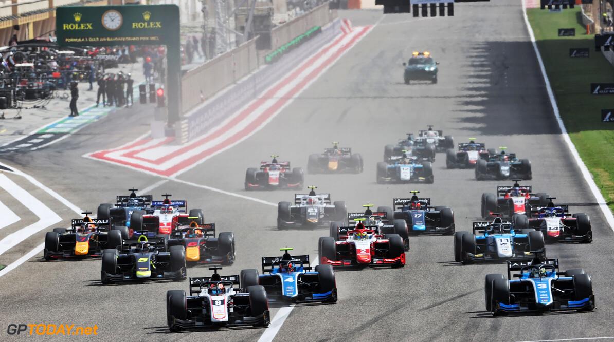FIA Formula 2 Championship (L to R): Christian Lundgaard (DEN) ART and Guanyu Zhou (CHN) Uni-Virtuosi Racing at the start of the race.  28.03.2021. FIA Formula 2 Championship, Rd 1, Feature Race, Sakhir, Bahrain, Sunday.  - www.xpbimages.com, EMail: requests@xpbimages.com Copyright: XPB Images Motor Racing - FIA Formula 2 Championship - Sunday - Sakhir, Bahrain xpbimages.com Sahkir Bahrain  F2 Bahrain International Circuit Bahrain Manama Sakhir Sunday Formula 2 Formula Two March 28 03 3 2021 Action Track