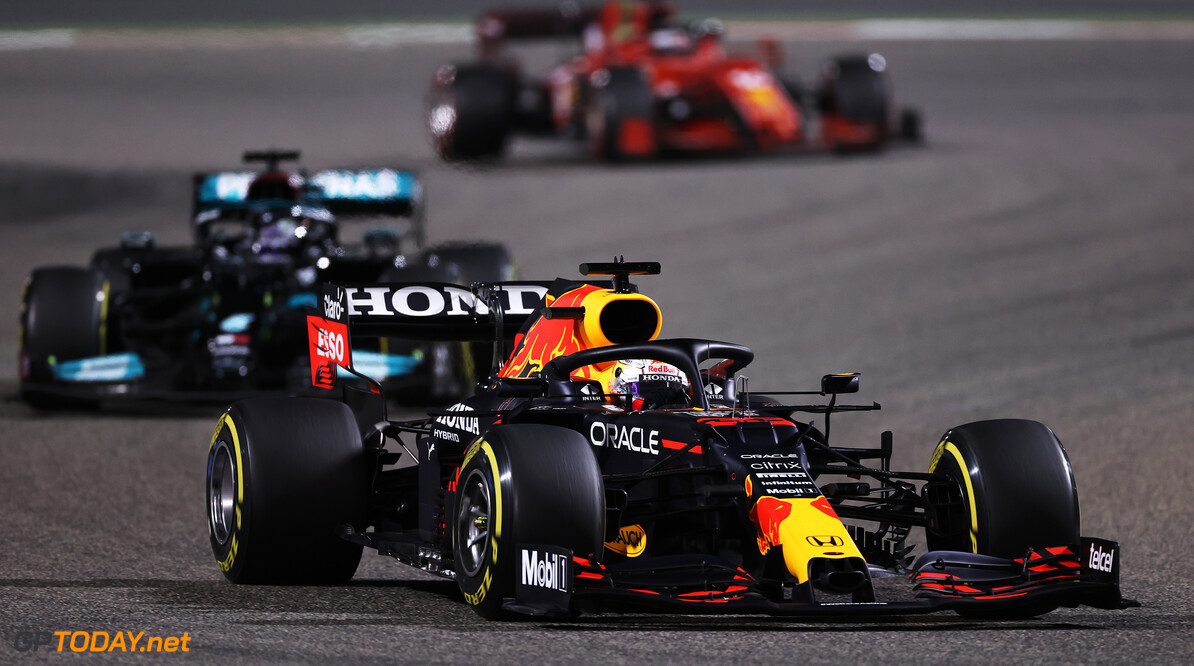 BAHRAIN, BAHRAIN - MARCH 28: Max Verstappen of the Netherlands driving the (33) Red Bull Racing RB16B Honda leads Lewis Hamilton of Great Britain driving the (44) Mercedes AMG Petronas F1 Team Mercedes W12 during the F1 Grand Prix of Bahrain at Bahrain International Circuit on March 28, 2021 in Bahrain, Bahrain. (Photo by Lars Baron/Getty Images) // Getty Images / Red Bull Content Pool  // SI202103280122 // Usage for editorial use only //  F1 Grand Prix of Bahrain     SI202103280122