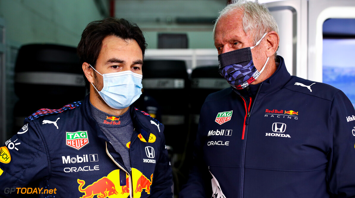 IMOLA, ITALY - APRIL 16: Sergio Perez of Mexico and Red Bull Racing talks with Red Bull Racing Team Consultant Dr Helmut Marko in the garage during practice ahead of the F1 Grand Prix of Emilia Romagna at Autodromo Enzo e Dino Ferrari on April 16, 2021 in Imola, Italy. (Photo by Mark Thompson/Getty Images) // Getty Images / Red Bull Content Pool  // SI202104160254 // Usage for editorial use only //  F1 Grand Prix of Emilia Romagna - Practice     SI202104160254