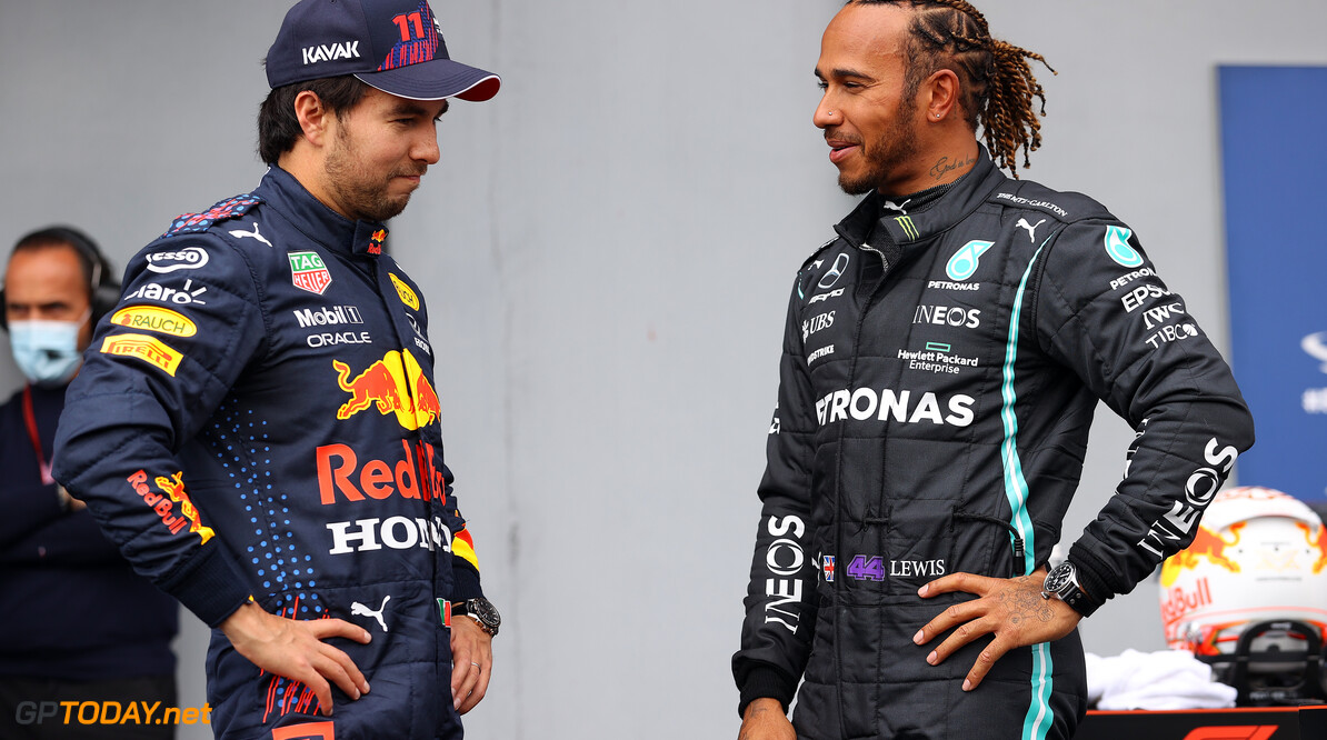 IMOLA, ITALY - APRIL 17: Second place qualifier Sergio Perez of Mexico and Red Bull Racing and pole position qualifier Lewis Hamilton of Great Britain and Mercedes GP talk in parc ferme during qualifying ahead of the F1 Grand Prix of Emilia Romagna at Autodromo Enzo e Dino Ferrari on April 17, 2021 in Imola, Italy. (Photo by Bryn Lennon/Getty Images) // Getty Images / Red Bull Content Pool  // SI202104170227 // Usage for editorial use only //  F1 Grand Prix of Emilia Romagna - Qualifying     SI202104170227