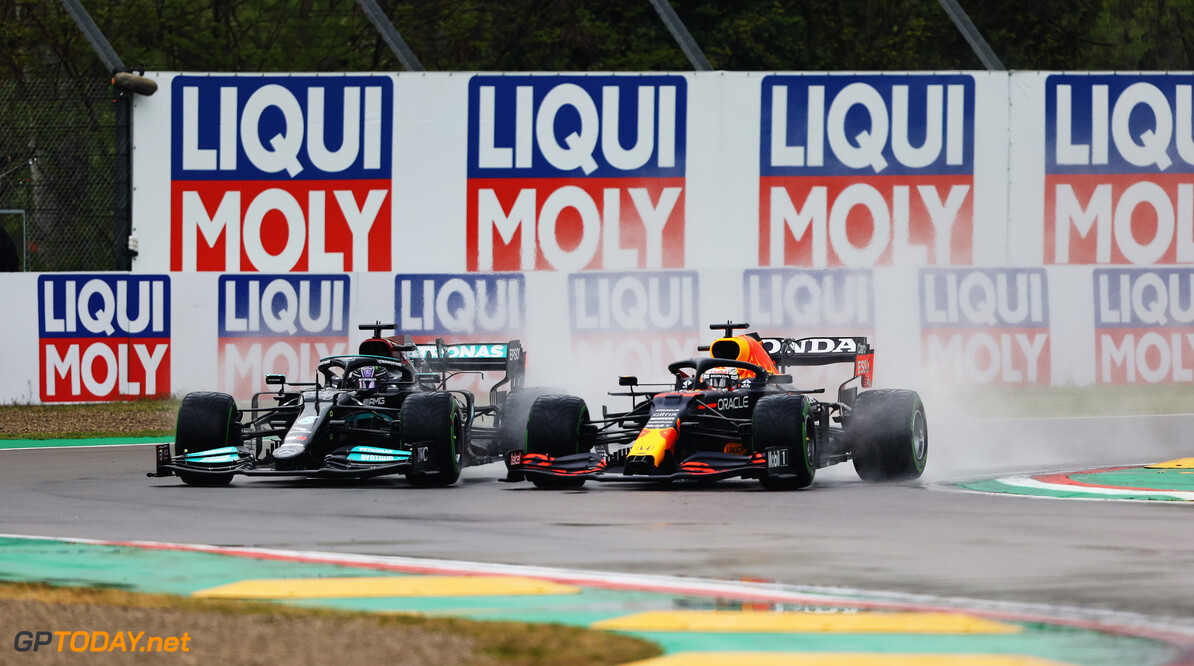 IMOLA, ITALY - APRIL 18: Lewis Hamilton of Great Britain driving the (44) Mercedes AMG Petronas F1 Team Mercedes W12 and Max Verstappen of the Netherlands driving the (33) Red Bull Racing RB16B Honda compete for position on track during the F1 Grand Prix of Emilia Romagna at Autodromo Enzo e Dino Ferrari on April 18, 2021 in Imola, Italy. (Photo by Bryn Lennon/Getty Images) // Getty Images / Red Bull Content Pool  // SI202104180176 // Usage for editorial use only //  F1 Grand Prix of Emilia Romagna     SI202104180176