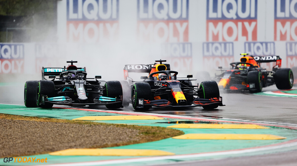 IMOLA, ITALY - APRIL 18: Lewis Hamilton of Great Britain driving the (44) Mercedes AMG Petronas F1 Team Mercedes W12 and Max Verstappen of the Netherlands driving the (33) Red Bull Racing RB16B Honda compete for position on track during the F1 Grand Prix of Emilia Romagna at Autodromo Enzo e Dino Ferrari on April 18, 2021 in Imola, Italy. (Photo by Bryn Lennon/Getty Images) // Getty Images / Red Bull Content Pool  // SI202104180168 // Usage for editorial use only //  F1 Grand Prix of Emilia Romagna     SI202104180168