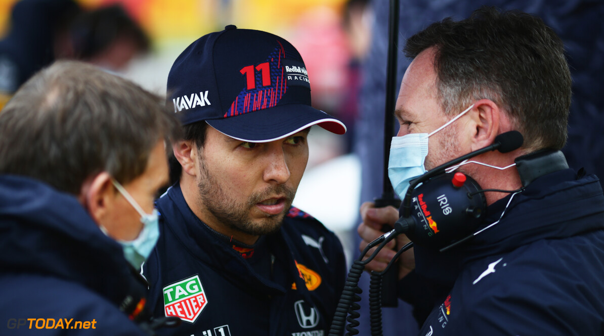 IMOLA, ITALY - APRIL 18: Red Bull Racing Team Principal Christian Horner speaks with Sergio Perez of Mexico and Red Bull Racing on the grid prior to the F1 Grand Prix of Emilia Romagna at Autodromo Enzo e Dino Ferrari on April 18, 2021 in Imola, Italy. (Photo by Peter Fox/Getty Images) // Getty Images / Red Bull Content Pool  // SI202104180153 // Usage for editorial use only //  F1 Grand Prix of Emilia Romagna     SI202104180153
