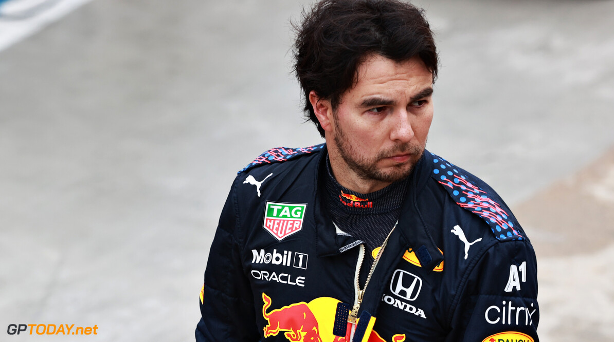 IMOLA, ITALY - APRIL 18: Sergio Perez of Mexico and Red Bull Racing looks on in the Pitlane during the red flag delay period during the F1 Grand Prix of Emilia Romagna at Autodromo Enzo e Dino Ferrari on April 18, 2021 in Imola, Italy. (Photo by Mark Thompson/Getty Images) // Getty Images / Red Bull Content Pool  // SI202104180267 // Usage for editorial use only //  F1 Grand Prix of Emilia Romagna     SI202104180267
