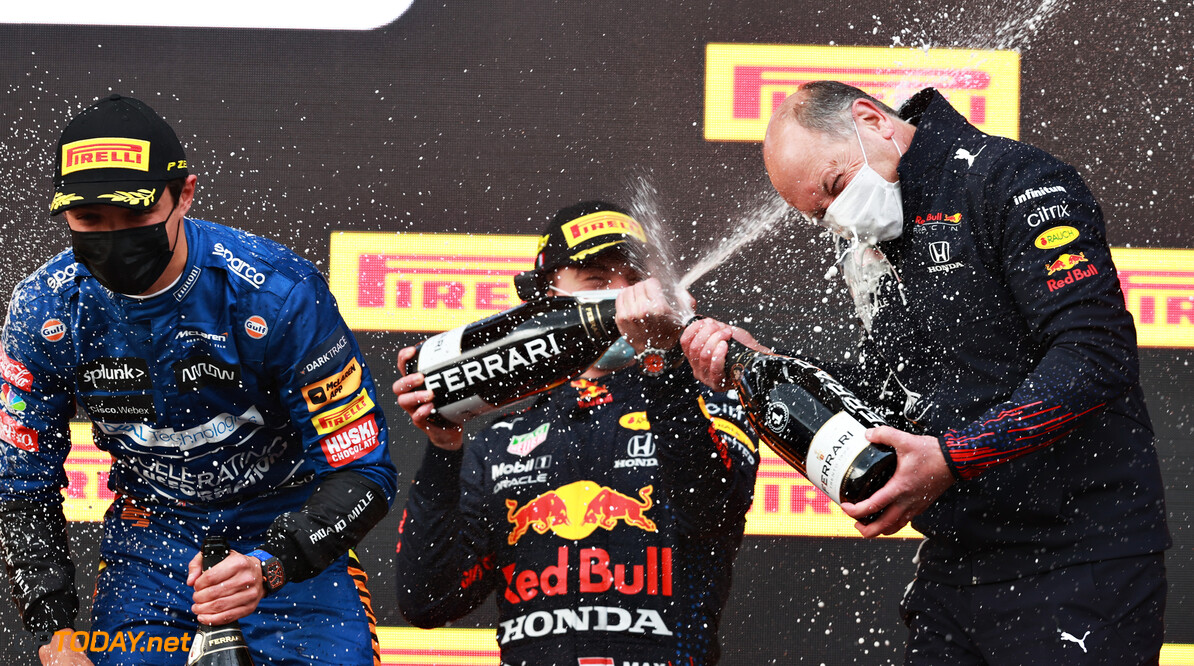 IMOLA, ITALY - APRIL 18: Race winner Max Verstappen of Netherlands and Red Bull Racing, Alastair Rew, Financial Director of Red Bull Racing and third placed Lando Norris of Great Britain and McLaren F1 celebrate on the podium with sparkling wine after the F1 Grand Prix of Emilia Romagna at Autodromo Enzo e Dino Ferrari on April 18, 2021 in Imola, Italy. (Photo by Mark Thompson/Getty Images) // Getty Images / Red Bull Content Pool  // SI202104180557 // Usage for editorial use only //  F1 Grand Prix of Emilia Romagna     SI202104180557