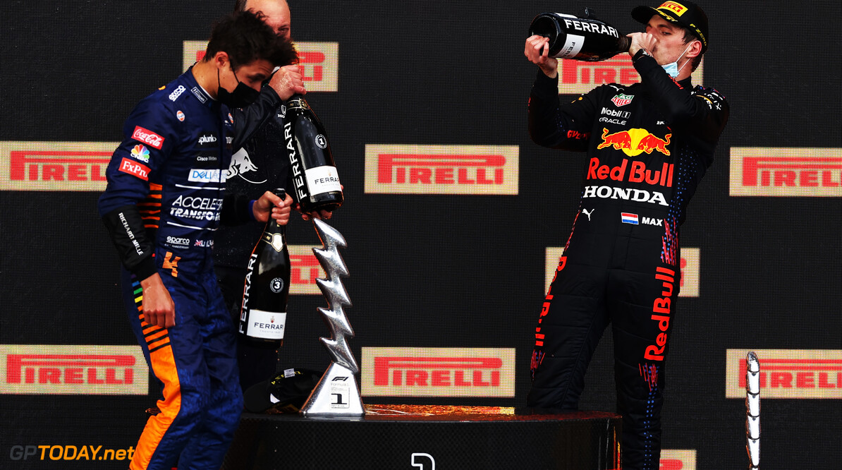 IMOLA, ITALY - APRIL 18: Third placed Lando Norris of Great Britain and McLaren F1, Alastair Rew, Financial Director of Red Bull Racing, and race winner Max Verstappen of Netherlands and Red Bull Racing celebrate on the podium after the F1 Grand Prix of Emilia Romagna at Autodromo Enzo e Dino Ferrari on April 18, 2021 in Imola, Italy. (Photo by Lars Baron/Getty Images) // Getty Images / Red Bull Content Pool  // SI202104180431 // Usage for editorial use only //  F1 Grand Prix of Emilia Romagna     SI202104180431