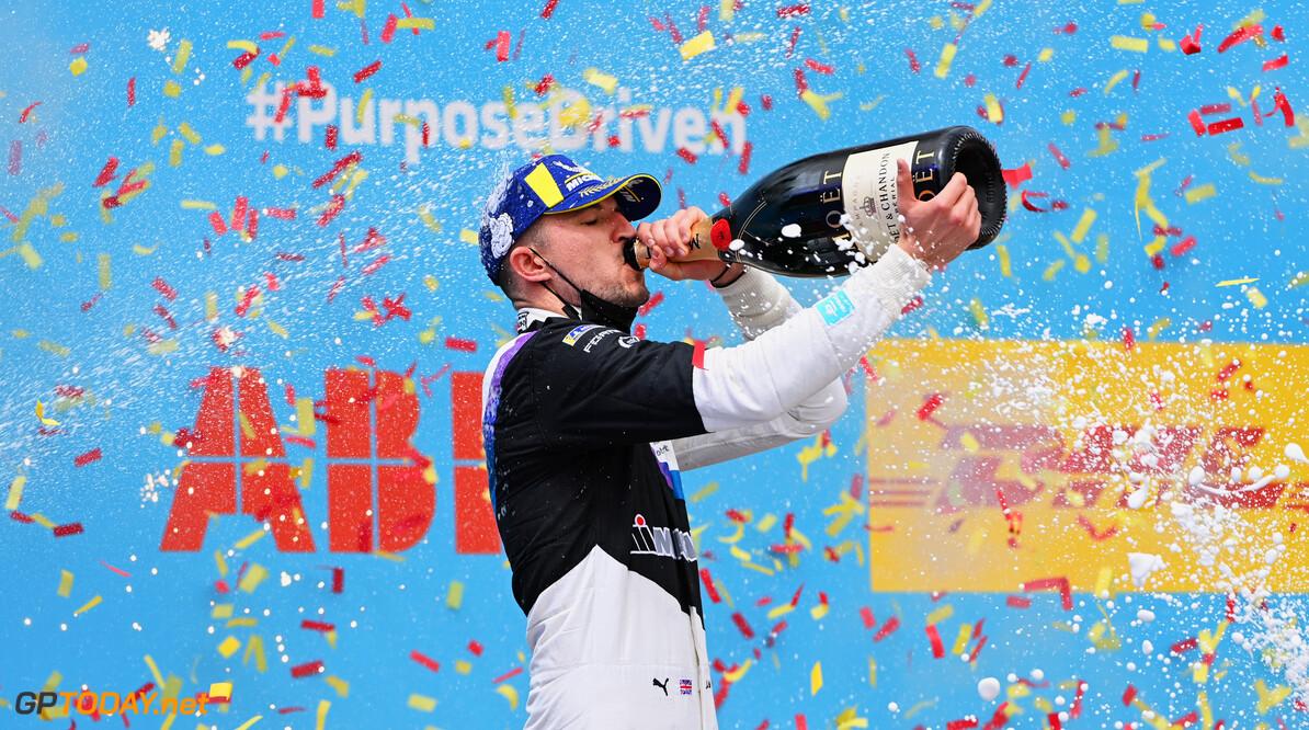 Jake Dennis (GBR), BMW I Andretti Motorsport, 1st position, drinks champagne on the podium  Sam Bagnall Valencia Spain  podium TS-Live Sunday BMW