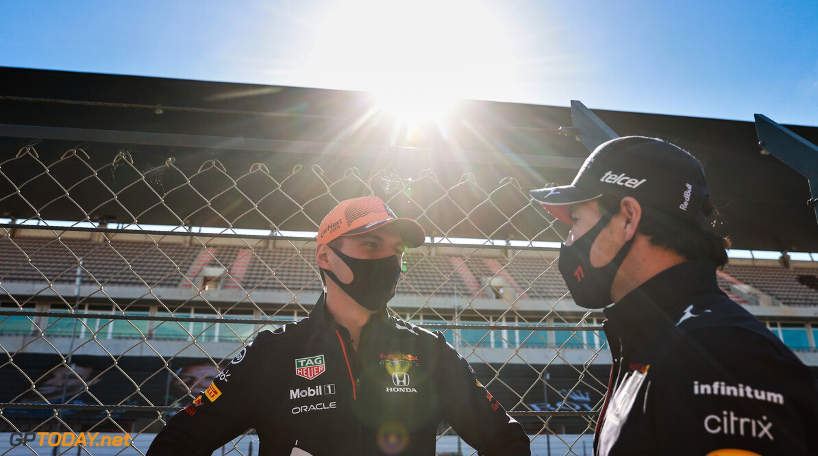 PORTIMAO, PORTUGAL - APRIL 29: Max Verstappen of Netherlands and Red Bull Racing and Sergio Perez of Mexico and Red Bull Racing talk in the Pitlane during previews ahead of the F1 Grand Prix of Portugal at Autodromo Internacional Do Algarve on April 29, 2021 in Portimao, Portugal. (Photo by Mark Thompson/Getty Images) // Getty Images / Red Bull Content Pool  // SI202104290399 // Usage for editorial use only //  F1 Grand Prix of Portugal - Previews     SI202104290399