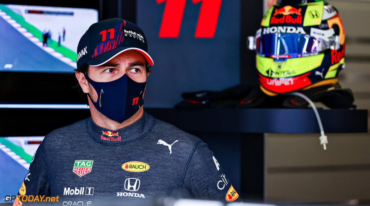 PORTIMAO, PORTUGAL - APRIL 30: Sergio Perez of Mexico and Red Bull Racing prepares to drive in the garage during practice ahead of the F1 Grand Prix of Portugal at Autodromo Internacional Do Algarve on April 30, 2021 in Portimao, Portugal. (Photo by Mark Thompson/Getty Images) // Getty Images / Red Bull Content Pool  // SI202104300958 // Usage for editorial use only //  F1 Grand Prix of Portugal - Practice     SI202104300958