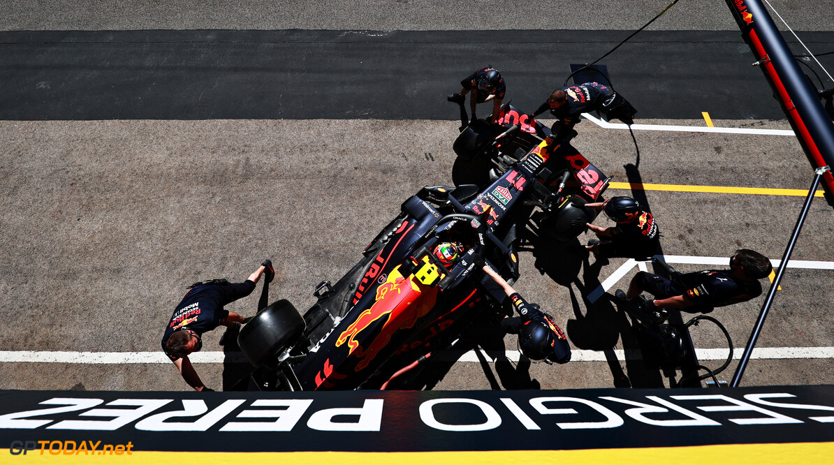 PORTIMAO, PORTUGAL - APRIL 30: Sergio Perez of Mexico driving the (11) Red Bull Racing RB16B Honda is pushed back into the garage during practice ahead of the F1 Grand Prix of Portugal at Autodromo Internacional Do Algarve on April 30, 2021 in Portimao, Portugal. (Photo by Mark Thompson/Getty Images) // Getty Images / Red Bull Content Pool  // SI202105010261 // Usage for editorial use only //  F1 Grand Prix of Portugal - Practice     SI202105010261