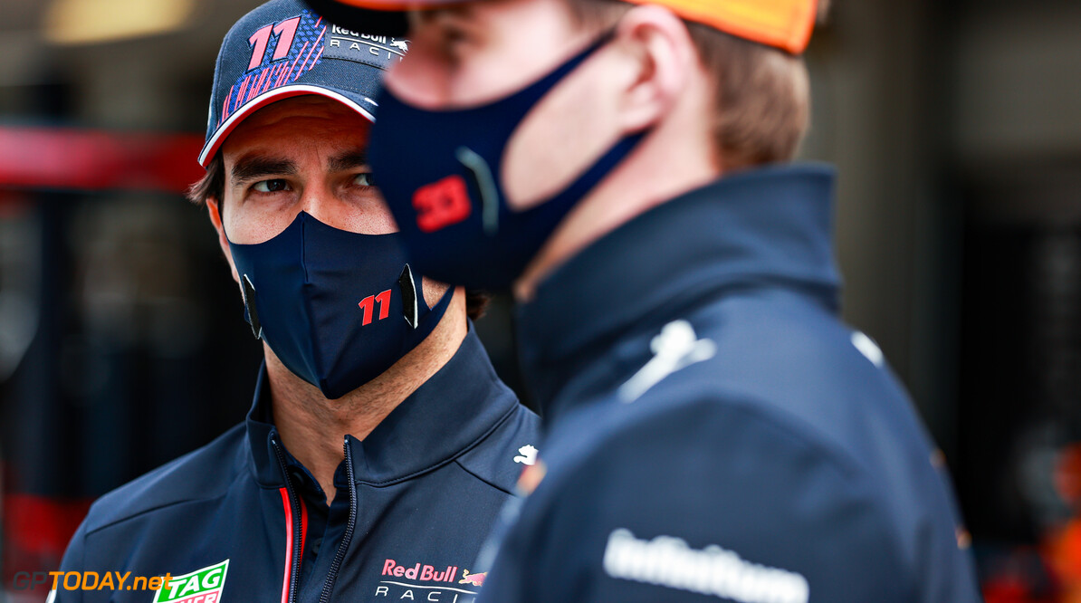 PORTIMAO, PORTUGAL - MAY 02: Max Verstappen of Netherlands and Red Bull Racing and Sergio Perez of Mexico and Red Bull Racing look on in the Paddock ahead of the F1 Grand Prix of Portugal at Autodromo Internacional Do Algarve on May 02, 2021 in Portimao, Portugal. (Photo by Mark Thompson/Getty Images) // Getty Images / Red Bull Content Pool  // SI202105020067 // Usage for editorial use only //  F1 Grand Prix of Portugal     SI202105020067