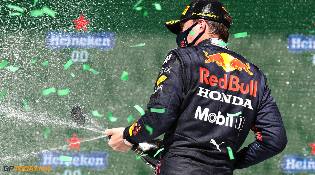 PORTIMAO, PORTUGAL - MAY 02: Second placed Max Verstappen of Netherlands and Red Bull Racing celebrates with sparkling wine on the podium during the F1 Grand Prix of Portugal at Autodromo Internacional Do Algarve on May 02, 2021 in Portimao, Portugal. (Photo by Mark Thompson/Getty Images) // Getty Images / Red Bull Content Pool  // SI202105020267 // Usage for editorial use only //  F1 Grand Prix of Portugal     SI202105020267