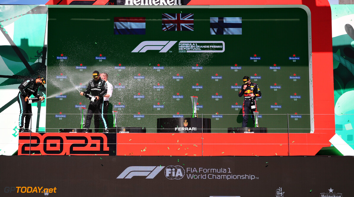 PORTIMAO, PORTUGAL - MAY 02: Second placed Max Verstappen of Netherlands and Red Bull Racing, race winner Lewis Hamilton of Great Britain and Mercedes GP and third placed Valtteri Bottas of Finland and Mercedes GP stand on the podium after the F1 Grand Prix of Portugal at Autodromo Internacional Do Algarve on May 02, 2021 in Portimao, Portugal. (Photo by Mark Thompson/Getty Images) // Getty Images / Red Bull Content Pool  // SI202105020503 // Usage for editorial use only //  F1 Grand Prix of Portugal     SI202105020503