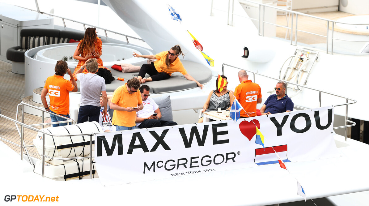 MONTE-CARLO, MONACO - MAY 23: Fans of Max Verstappen of Netherlands and Red Bull Racing display a flag from a boat in the harbour ahead of the F1 Grand Prix of Monaco at Circuit de Monaco on May 23, 2021 in Monte-Carlo, Monaco. (Photo by Bryn Lennon/Getty Images) // Getty Images / Red Bull Content Pool  // SI202105230039 // Usage for editorial use only //  F1 Grand Prix of Monaco     SI202105230039