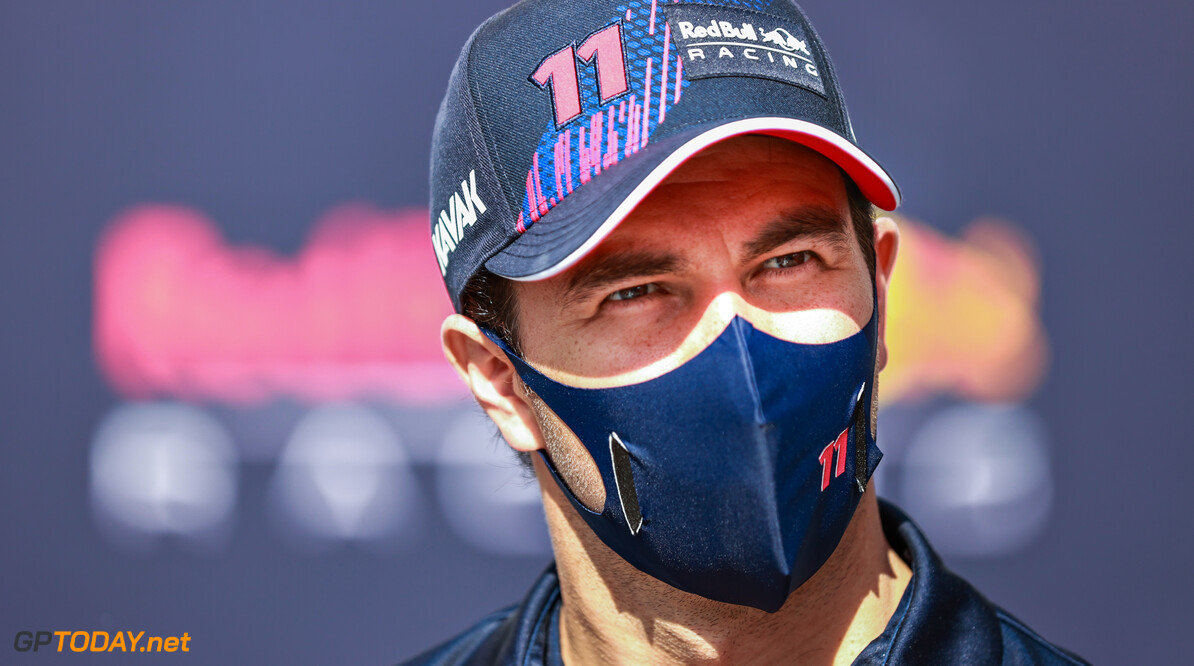 BAKU, AZERBAIJAN - JUNE 03: Sergio Perez of Mexico and Red Bull Racing looks on in the Paddock during previews ahead of the F1 Grand Prix of Azerbaijan at Baku City Circuit on June 03, 2021 in Baku, Azerbaijan. (Photo by Mark Thompson/Getty Images) // Getty Images / Red Bull Content Pool  // SI202106030210 // Usage for editorial use only //  F1 Grand Prix of Azerbaijan - Previews     SI202106030210