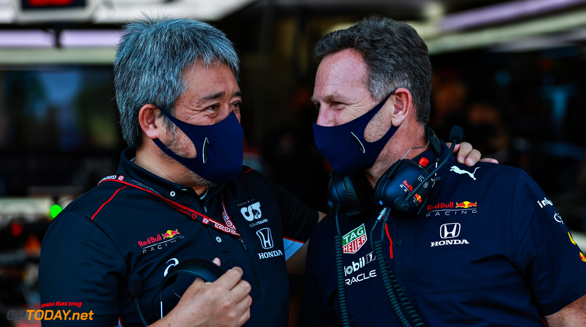 BAKU, AZERBAIJAN - JUNE 04: Masashi Yamamoto of Honda talks with Red Bull Racing Team Principal Christian Horner in the garage during practice ahead of the F1 Grand Prix of Azerbaijan at Baku City Circuit on June 04, 2021 in Baku, Azerbaijan. (Photo by Mark Thompson/Getty Images) // Getty Images / Red Bull Content Pool  // SI202106040321 // Usage for editorial use only //  F1 Grand Prix of Azerbaijan - Practice     SI202106040321