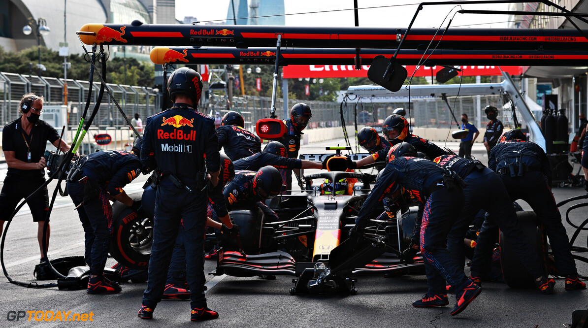 BAKU, AZERBAIJAN - JUNE 06: Sergio Perez of Mexico driving the (11) Red Bull Racing RB16B Honda makes a pitstop during the F1 Grand Prix of Azerbaijan at Baku City Circuit on June 06, 2021 in Baku, Azerbaijan. (Photo by Mark Thompson/Getty Images) // Getty Images / Red Bull Content Pool  // SI202106060145 // Usage for editorial use only //  F1 Grand Prix of Azerbaijan     SI202106060145