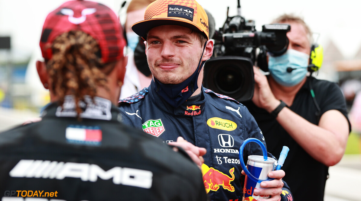 LE CASTELLET, FRANCE - JUNE 19: Pole position qualifier Max Verstappen of Netherlands and Red Bull Racing and second placed qualifier Lewis Hamilton of Great Britain and Mercedes GP interact in parc ferme during qualifying ahead of the F1 Grand Prix of France at Circuit Paul Ricard on June 19, 2021 in Le Castellet, France. (Photo by Mark Thompson/Getty Images) // Getty Images / Red Bull Content Pool  // SI202106190212 // Usage for editorial use only //  F1 Grand Prix of France - Qualifying     SI202106190212