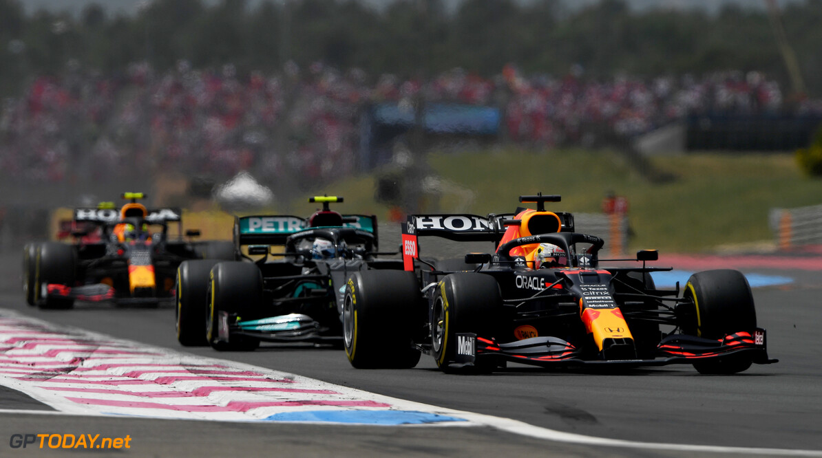 LE CASTELLET, FRANCE - JUNE 20: Max Verstappen of the Netherlands driving the (33) Red Bull Racing RB16B Honda leads Valtteri Bottas of Finland driving the (77) Mercedes AMG Petronas F1 Team Mercedes W12 during the F1 Grand Prix of France at Circuit Paul Ricard on June 20, 2021 in Le Castellet, France. (Photo by Rudy Carezzevoli/Getty Images) // Getty Images / Red Bull Content Pool  // SI202106200310 // Usage for editorial use only //  F1 Grand Prix of France     SI202106200310
