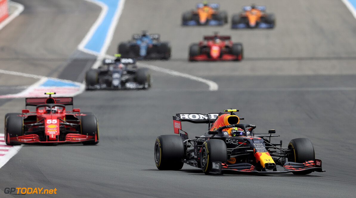 LE CASTELLET, FRANCE - JUNE 20: Sergio Perez of Mexico driving the (11) Red Bull Racing RB16B Honda leads Carlos Sainz of Spain driving the (55) Scuderia Ferrari SF21 during the F1 Grand Prix of France at Circuit Paul Ricard on June 20, 2021 in Le Castellet, France. (Photo by Clive Rose/Getty Images) // Getty Images / Red Bull Content Pool  // SI202106200351 // Usage for editorial use only //  F1 Grand Prix of France     SI202106200351