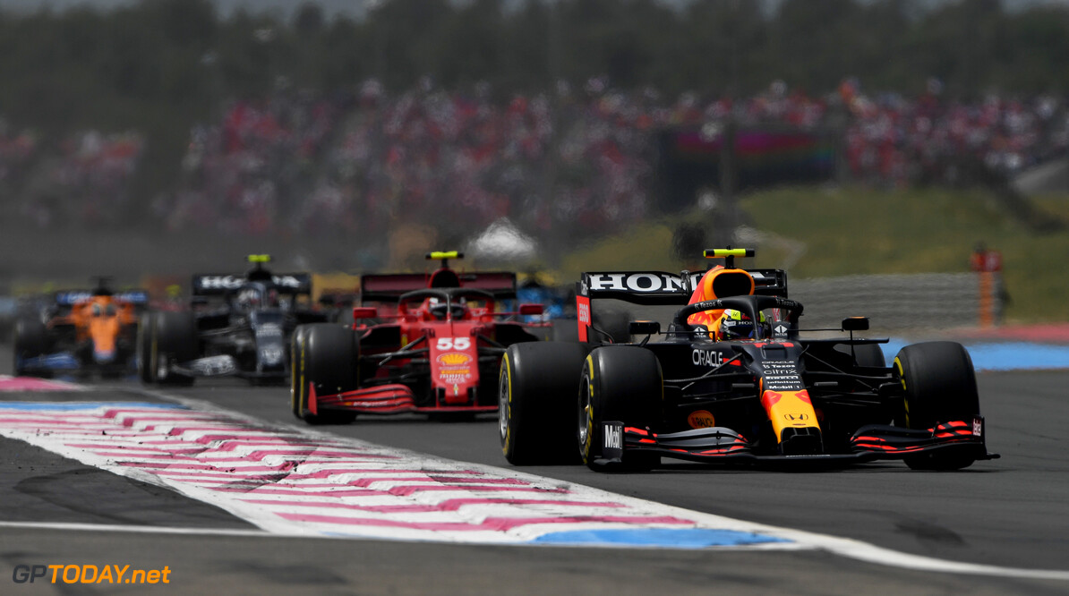 LE CASTELLET, FRANCE - JUNE 20: Sergio Perez of Mexico driving the (11) Red Bull Racing RB16B Honda leads Carlos Sainz of Spain driving the (55) Scuderia Ferrari SF21 during the F1 Grand Prix of France at Circuit Paul Ricard on June 20, 2021 in Le Castellet, France. (Photo by Rudy Carezzevoli/Getty Images) // Getty Images / Red Bull Content Pool  // SI202106200274 // Usage for editorial use only //  F1 Grand Prix of France     SI202106200274