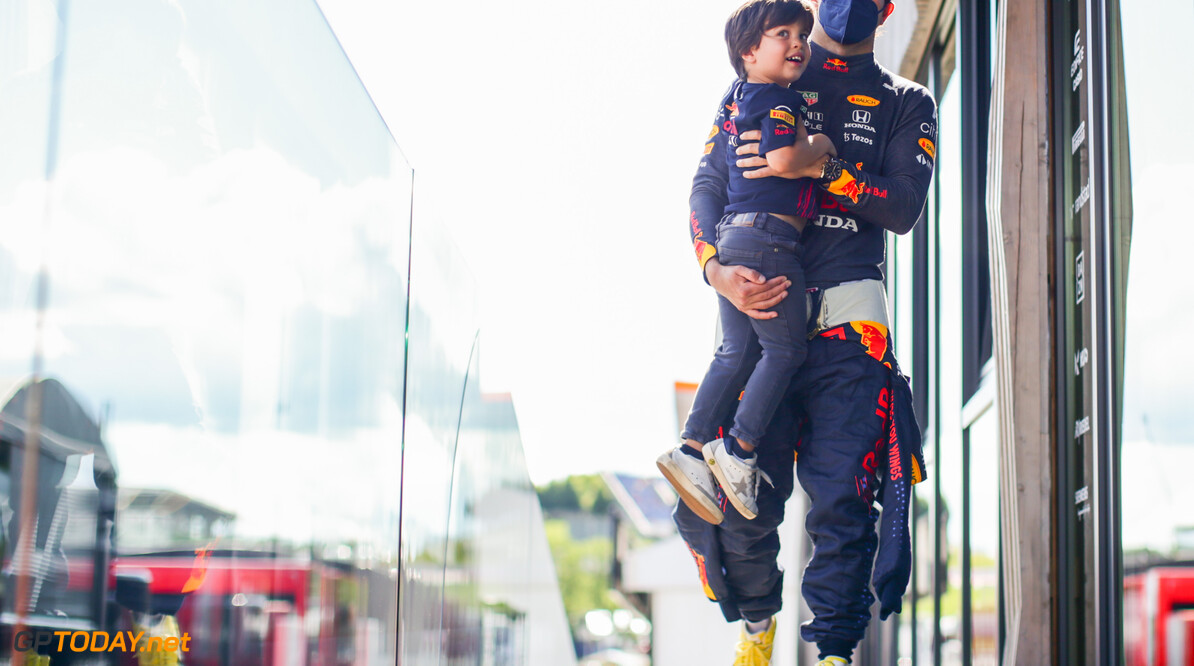 SPIELBERG, AUSTRIA - JUNE 26: Sergio Perez of Mexico and Red Bull Racing with his son Sergio qualifying ahead of the F1 Grand Prix of Styria at Red Bull Ring on June 26, 2021 in Spielberg, Austria. (Photo by Peter Fox/Getty Images) // Getty Images / Red Bull Content Pool  // SI202106270017 // Usage for editorial use only //  F1 Grand Prix of Styria - Qualifying     SI202106270017
