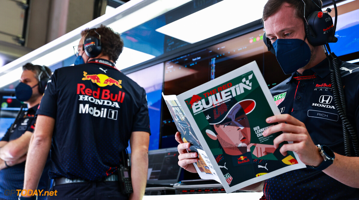 SPIELBERG, AUSTRIA - JUNE 27: A Red Bull Racing team member reads the Red Bulletin in the garage ahead of the F1 Grand Prix of Styria at Red Bull Ring on June 27, 2021 in Spielberg, Austria. (Photo by Mark Thompson/Getty Images) // Getty Images / Red Bull Content Pool  // SI202106270170 // Usage for editorial use only //  F1 Grand Prix of Styria     SI202106270170