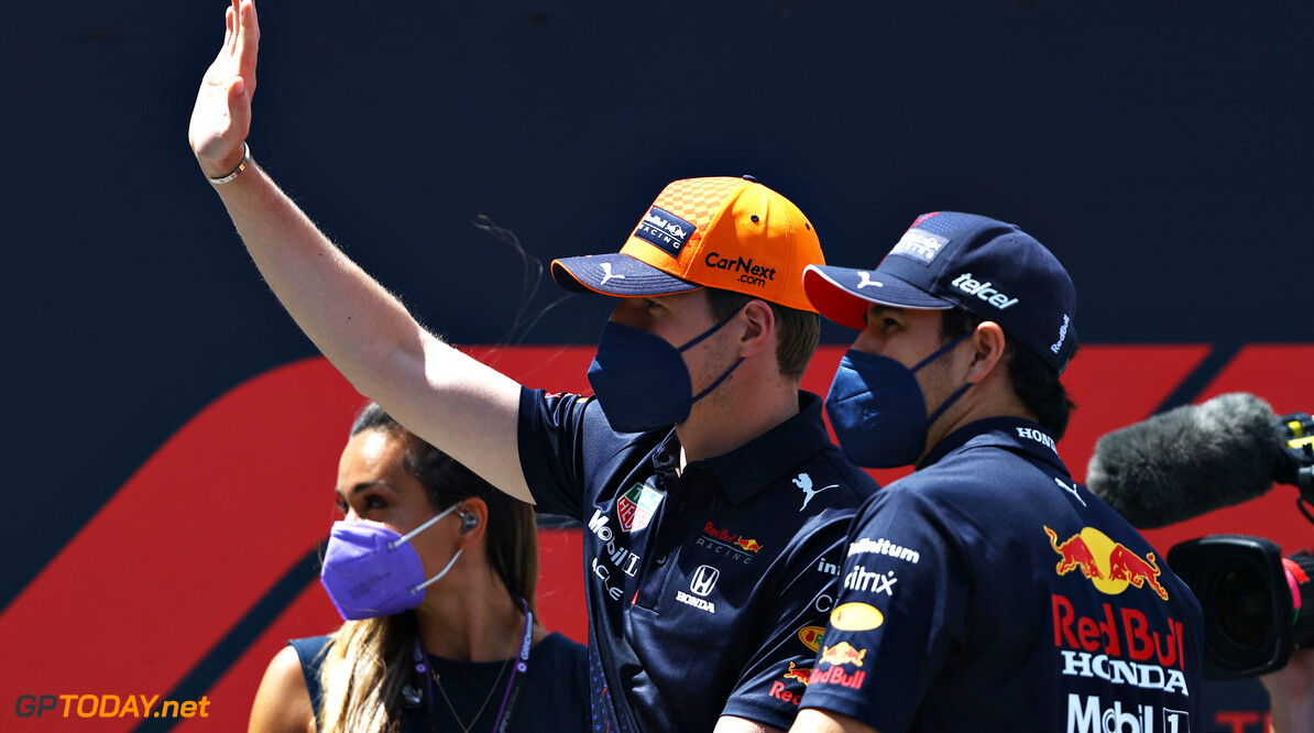 SPIELBERG, AUSTRIA - JUNE 27: Max Verstappen of Netherlands and Red Bull Racing and Sergio Perez of Mexico and Red Bull Racing look on from the drivers parade ahead of the F1 Grand Prix of Styria at Red Bull Ring on June 27, 2021 in Spielberg, Austria. (Photo by Bryn Lennon/Getty Images) // Getty Images / Red Bull Content Pool  // SI202106270156 // Usage for editorial use only //  F1 Grand Prix of Styria     SI202106270156