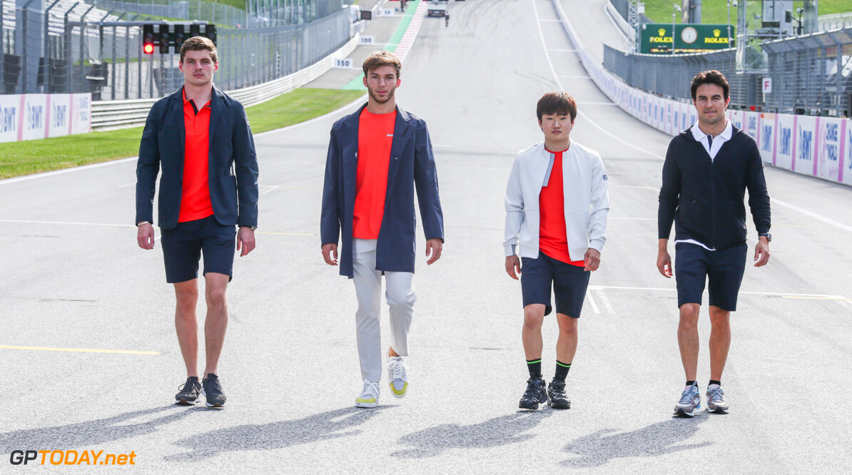 SPIELBERG, AUSTRIA - JUNE 24: Max Verstappen of Netherlands and Red Bull Racing, Pierre Gasly of France and Scuderia AlphaTauri, Sergio Perez of Mexico and Red Bull Racing and Yuki Tsunoda of Japan and Scuderia AlphaTauri pose for a photo in AlphaTauri clothing during previews ahead of the F1 Grand Prix of Styria at Red Bull Ring on June 24, 2021 in Spielberg, Austria. (Photo by Peter Fox/Getty Images) // Getty Images / Red Bull Content Pool  // SI202107030098 // Usage for editorial use only //  F1 Grand Prix of Styria - Previews     SI202107030098