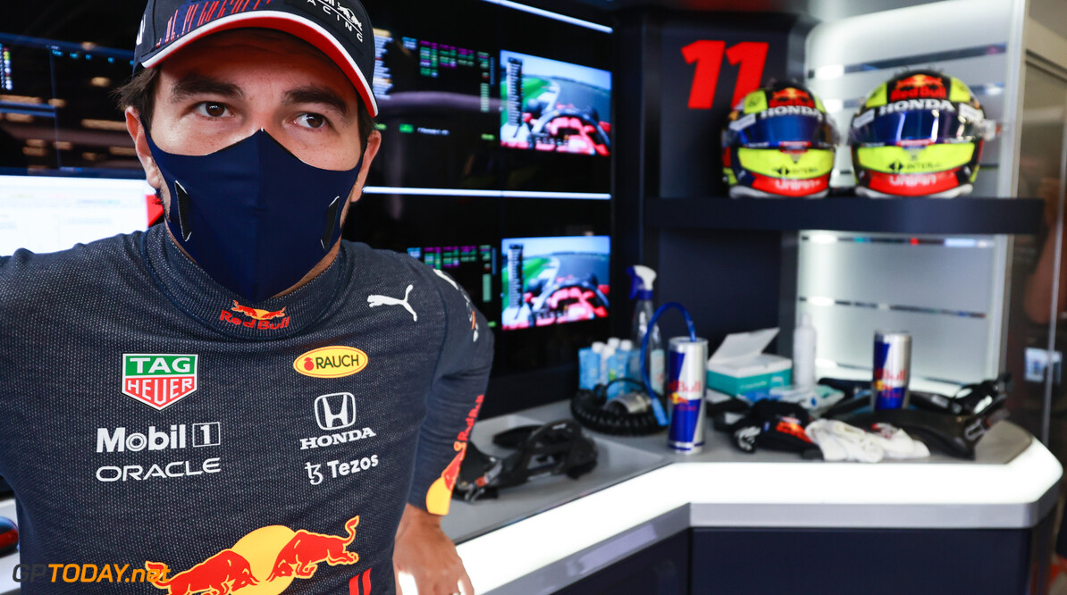 NORTHAMPTON, ENGLAND - JULY 17: Sergio Perez of Mexico and Red Bull Racing prepares to drive in the garage during practice ahead of the F1 Grand Prix of Great Britain at Silverstone on July 17, 2021 in Northampton, England. (Photo by Mark Thompson/Getty Images) // Getty Images / Red Bull Content Pool  // SI202107170119 // Usage for editorial use only //  F1 Grand Prix of Great Britain - Practice     SI202107170119