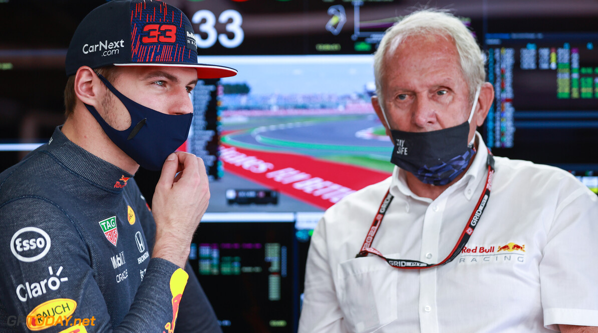 NORTHAMPTON, ENGLAND - JULY 17: Max Verstappen of Netherlands and Red Bull Racing and Red Bull Racing Team Consultant Dr Helmut Marko look on in the garage during practice ahead of the F1 Grand Prix of Great Britain at Silverstone on July 17, 2021 in Northampton, England. (Photo by Mark Thompson/Getty Images) // Getty Images / Red Bull Content Pool  // SI202107170195 // Usage for editorial use only //  F1 Grand Prix of Great Britain - Practice     SI202107170195