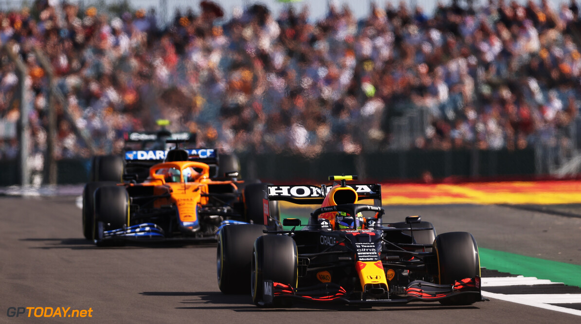 NORTHAMPTON, ENGLAND - JULY 17: Sergio Perez of Mexico driving the (11) Red Bull Racing RB16B Honda leads Daniel Ricciardo of Australia driving the (3) McLaren F1 Team MCL35M Mercedes during the Sprint for the F1 Grand Prix of Great Britain at Silverstone on July 17, 2021 in Northampton, England. (Photo by Lars Baron/Getty Images) // Getty Images / Red Bull Content Pool  // SI202107170350 // Usage for editorial use only //  F1 Grand Prix of Great Britain - Sprint     SI202107170350