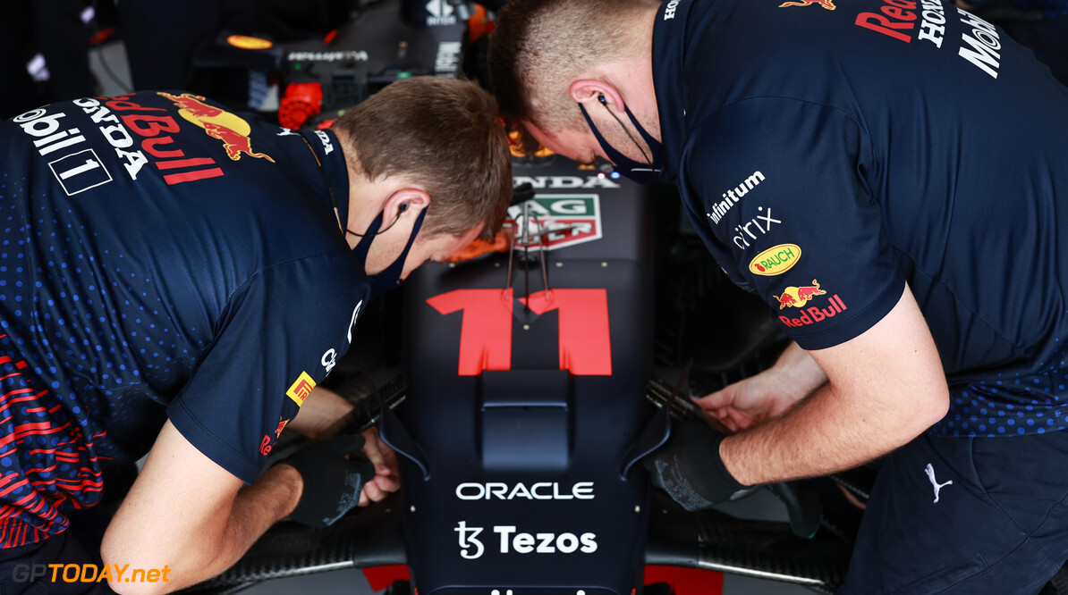 BUDAPEST, HUNGARY - JULY 31: The Red Bull Racing team work on the car of Sergio Perez of Mexico and Red Bull Racing during final practice ahead of the F1 Grand Prix of Hungary at Hungaroring on July 31, 2021 in Budapest, Hungary. (Photo by Mark Thompson/Getty Images) // Getty Images / Red Bull Content Pool  // SI202107310196 // Usage for editorial use only //  F1 Grand Prix of Hungary - Final Practice     SI202107310196