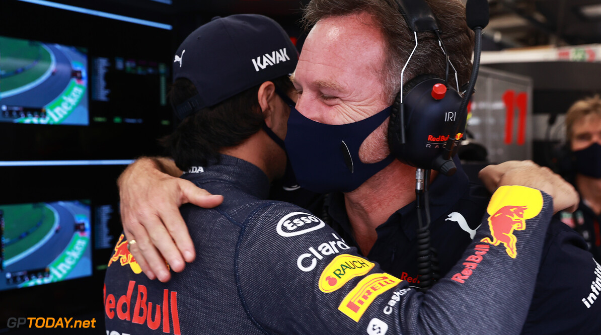 BUDAPEST, HUNGARY - JULY 31: Sergio Perez of Mexico and Red Bull Racing and Red Bull Racing Team Principal Christian Horner hug in the garage during final practice ahead of the F1 Grand Prix of Hungary at Hungaroring on July 31, 2021 in Budapest, Hungary. (Photo by Mark Thompson/Getty Images) // Getty Images / Red Bull Content Pool  // SI202107310159 // Usage for editorial use only //  F1 Grand Prix of Hungary - Final Practice     SI202107310159